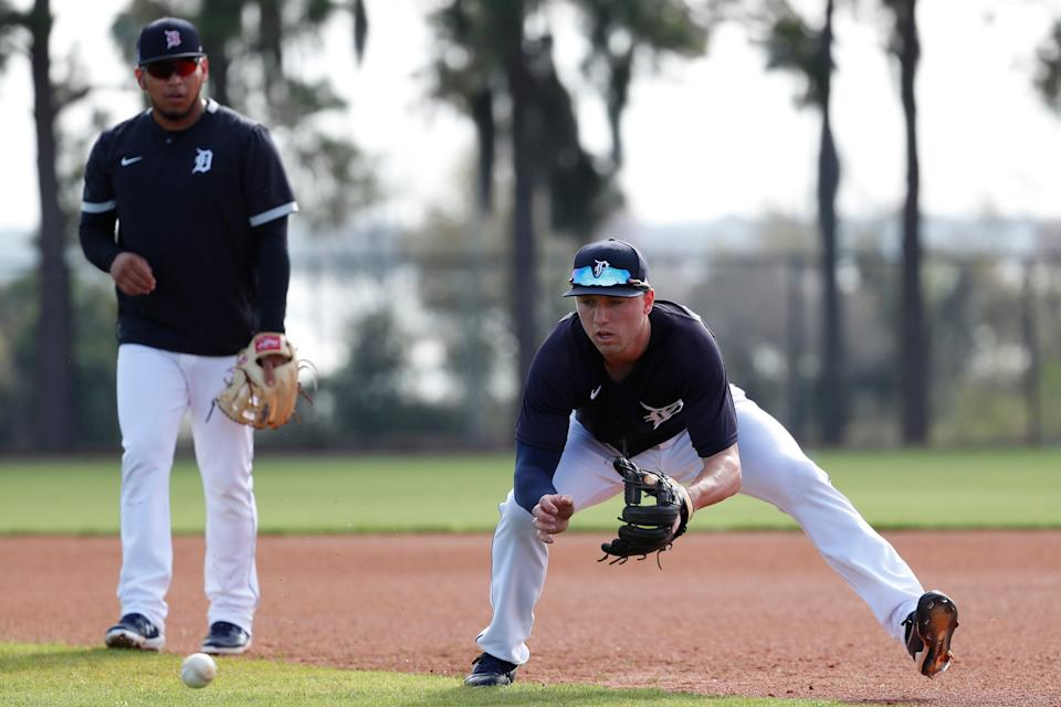Infielder Kody Clemens practices as Isaac Paredes watches during Detroit Tigers spring training at TigerTown in Lakeland, Fla., Wednesday, Feb. 19, 2020.