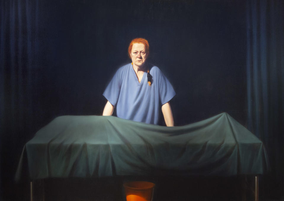 Unknown Man shows Professor Black in surgical robes standing behind the covered remains of a body