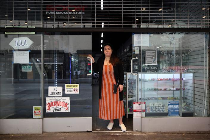Natali Mishali, 30, stands outside her closed DTLA Smoke Shop in Los Angeles. It has since reopened, after she spent more than $20,000 in legal fees.