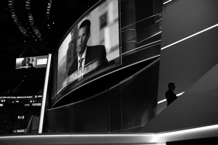 <p>Sen. Ted Cruz leaves the stage as Donald Trump Jr. is seen on the big screen. (Photo: Khue Bui for Yahoo News)</p>