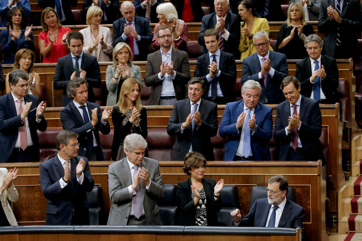 Prime Minister Mariano Rajoy, bottom right, is applauded by party members after his speech at the Spanish Parliament in Madrid on Wednesday. (Photo: Paul White/AP)