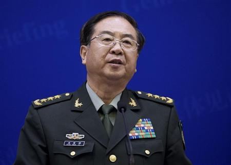 Chief of the general staff of China's People's Liberation Army Fang speaks during a press briefing with U.S. Joint Chiefs Chairman General Dempsey in Beijing