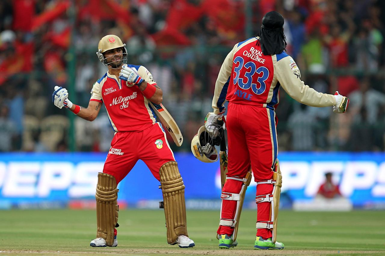 Virat Kohli and Chris Gayle celebrates 150 runs of Chris Gayle during match 31 of the Pepsi Indian Premier League between The Royal Challengers Bangalore and The Pune Warriors India held at the M. Chinnaswamy Stadium, Bengaluru  on the 23rd April 2013Photo by Prashant Bhoot-IPL-SPORTZPICS  Use of this image is subject to the terms and conditions as outlined by the BCCI. These terms can be found by following this link:https://ec.yimg.com/ec?url=http%3a%2f%2fwww.sportzpics.co.za%2fimage%2fI0000SoRagM2cIEc&t=1498319958&sig=UKZeLElgFlcJB1Bp4BATrg--~C