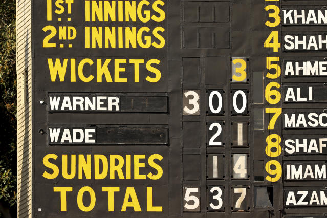 The scoreboard shows Australia's David Warner brings up his 300 during their cricket test match against Pakistan in Adelaide, Saturday, Nov. 30, 2019. (AP Photo/James Elsby)