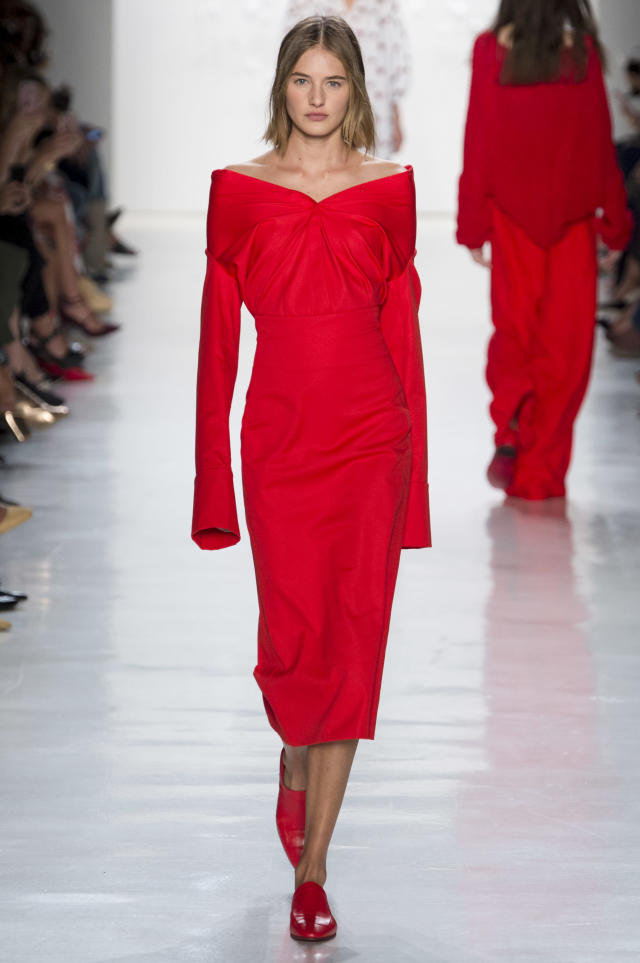 <p><i>Model wears an open-shoulder, crimson-red dress from the SS18 Noon by Noor collection. (Photo: ImaxTree) </i></p>