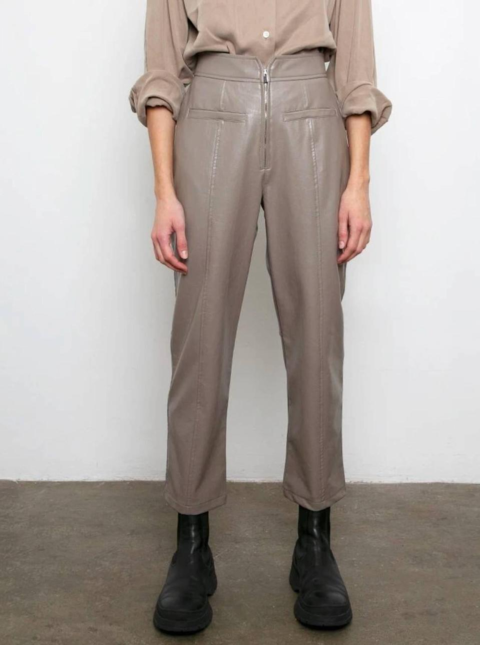 """$109, The Frankie Shop. <a href=""""https://thefrankieshop.com/products/zip-front-taupe-leather-pants?"""" rel=""""nofollow noopener"""" target=""""_blank"""" data-ylk=""""slk:Get it now!"""" class=""""link rapid-noclick-resp"""">Get it now!</a>"""