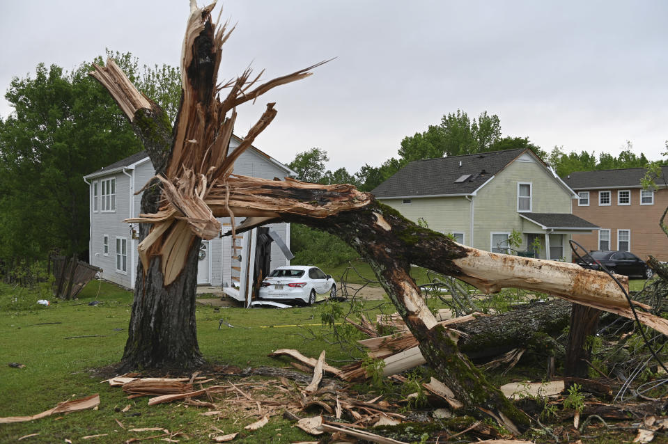 A downed tree and damaged homes are seen along Elvis Presley Drive in Tupelo, Miss., Monday, May 3, 2021. Multiple tornadoes were reported across Mississippi on Sunday, causing some damage but no immediate word of injuries. (AP Photo/Thomas Graning)