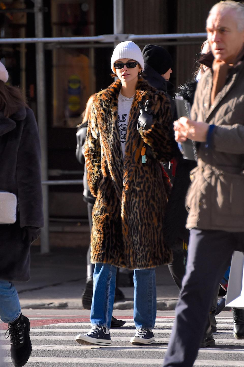 A leopard print coat and Converse? Doesn't get much comfier!
