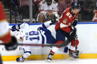 Tampa Bay Lightning left wing Ondrej Palat (18) goes against the boards as he chased the puck with Florida Panthers defenseman Brandon Montour (62) during the first period in Game 2 of an NHL hockey Stanley Cup first-round playoff series Tuesday, May 18, 2021, in Sunrise, Fla. (AP Photo/Lynne Sladky)