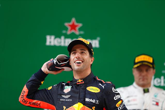 Shoe-in: There were tears, laughter and the inevitable 'shooey' of champagne on the podium for race winner Daniel Ricciardo
