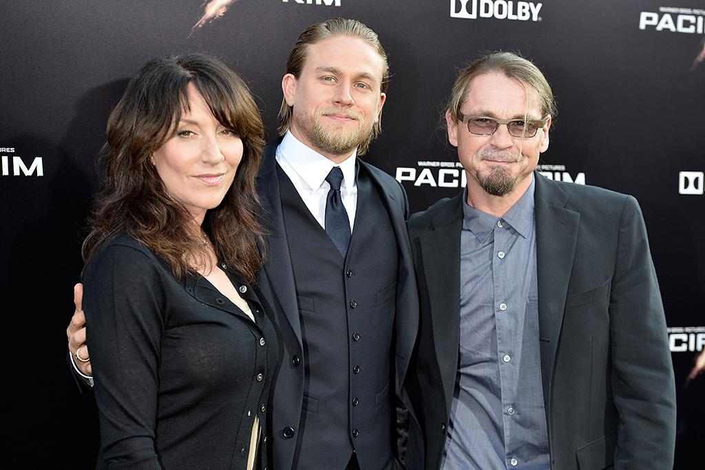 "HOLLYWOOD, CA - JULY 09:  (L-R) Actors Katey Sagal and Charlie Hunnam and writer/producer Kurt Sutter arrive at the premiere of Warner Bros. Pictures' and Legendary Pictures' ""Pacific Rim"" at Dolby Theatre on July 9, 2013 in Hollywood, California.  (Photo by Frazer Harrison/Getty Images)"