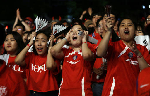 South Korean soccer fans react as they watch a live broadcasting of the Group F World Cup soccer match between South Korea and Sweden, at a public viewing venue in Seoul, South Korea, Monday, June 18, 2018. (AP Photo/Ahn Young-joon)