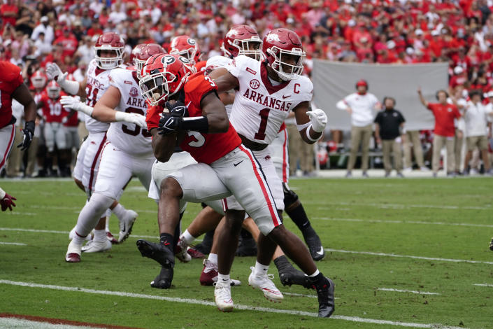Georgia running back Zamir White (3) gets past Arkansas defensive back Jalen Catalon (1) to score a touchdown during the first half of an NCAA college football game Saturday, Oct. 2, 2021, in Athens, Ga.. (AP Photo/John Bazemore)
