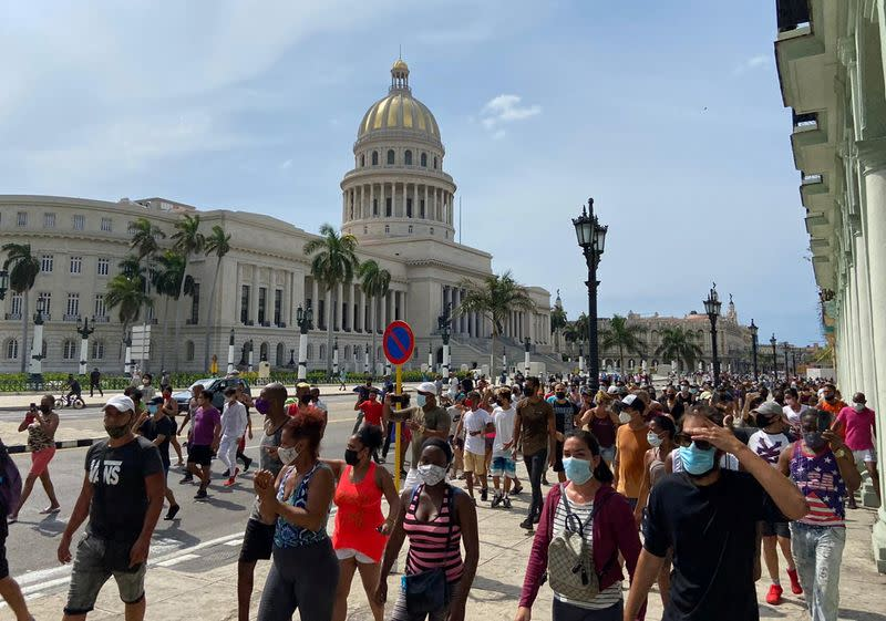 People gather during protests against and in support of the government, in Havana