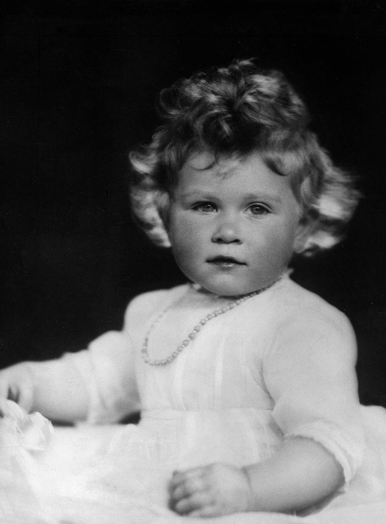 """<p>A portrait of the young future queen, who bears more than a passing resemblance to her <a href=""""https://www.townandcountrymag.com/society/tradition/news/a8023/princess-charlotte-balloons/"""" rel=""""nofollow noopener"""" target=""""_blank"""" data-ylk=""""slk:great-granddaughter Charlotte"""" class=""""link rapid-noclick-resp"""">great-granddaughter Charlotte</a>.</p>"""