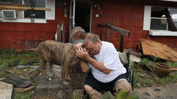 PHOTO: Steve Culver cries with his dog Otis as he talks about what he said was the, 'most terrifying event in his life,' when Hurricane Harvey blew in and destroyed most of his home while he and his wife took shelter, Aug. 26, 2017, in Rockport, Texas.  (Joe Raedle/Getty Images)