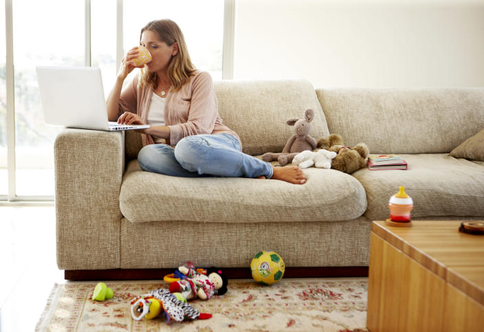 Video calling can mean suddenly your home — complete with piles of laundry, washing up and toys strewn around — is on view to your boss and colleagues. Photo: Getty