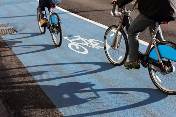 Cyclists riding on the London cycle superhighway.