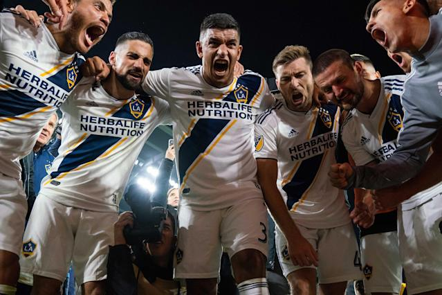 The LA Galaxy players aren't the only ones excited they'll face rival LAFC in the second round of the MLS Cup playoffs after beating Minnesota United 2-1 Sunday. (Brad Rempel/USA Today)