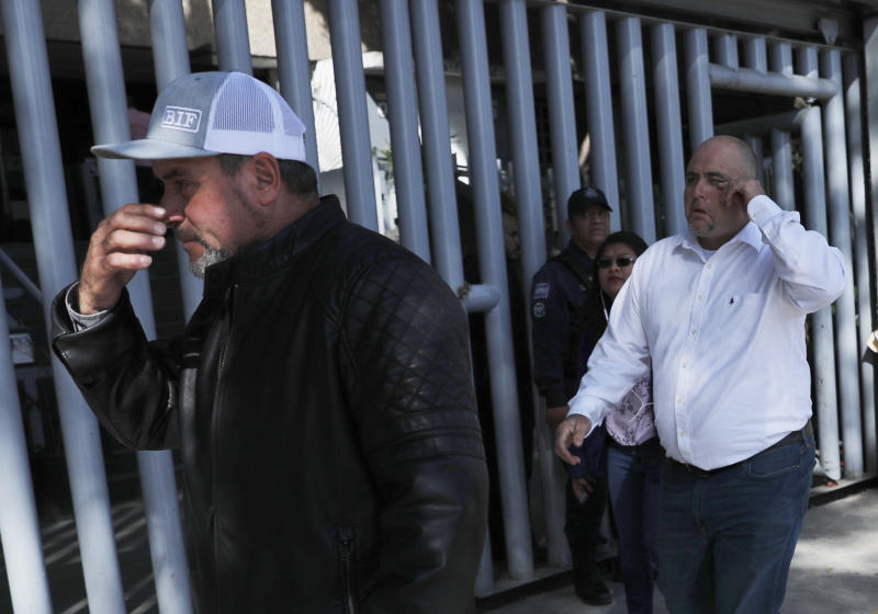 Adrian, left, and Julian LeBaron, who lost relatives and friends in a Nov. 4, 2019 ambush in northern Mexico, leave the office of the Special Prosecutor for Organized Crime Investigation, where they met with authorities in Mexico City, Tuesday, Jan. 7, 2020. Prosecutors said Tuesday more than 40 suspects have  been identified in connection with the slaughter of the nine U.S. dual-national women and children. (AP Photo/Marco Ugarte)
