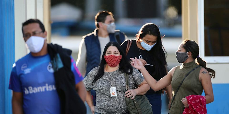 Employees leave JBS SA's poultry factory after the company was hit by an outbreak of the coronavirus disease (COVID-19), in Passo Fundo, state of Rio Grande do Sul, Brazil, April 24, 2020.