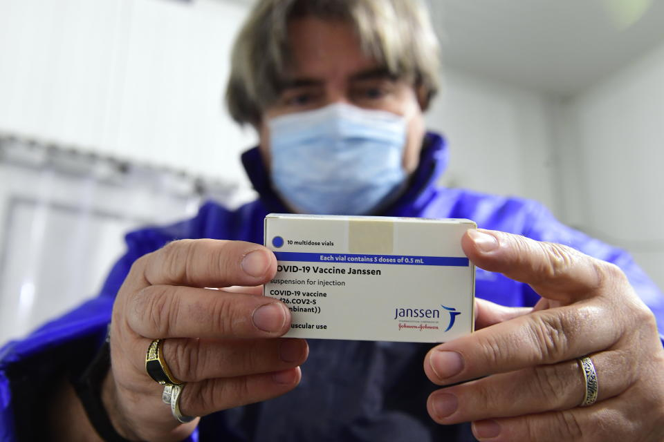 A box of Janssen vaccines is shown by pharmacist Zsolt Szenasi at a warehouse of Hungaropharma, a Hungarian pharmaceutical wholesale company, in Budapest, Hungary, after the arrival of the first batch of the Johnson & Johnson, US, made one-dose vaccine against the new coronavirus in the country Tuesday, April 13, 2021. The first shopment contains 28 thousand doses of Janssen. (Szilard Koszticsak/MTI via AP)