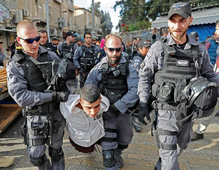 Israeli security forces detain a Palestinian youth in Jerusalem's Old City
