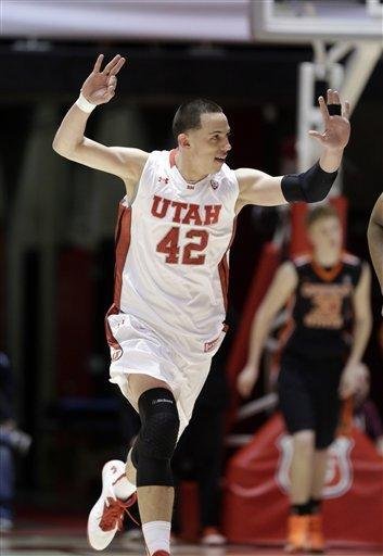 Utah's center Jason Washburn (42) celebrates after scoring against Oregon State in the first half during an NCAA college basketball game on Thursday, March 7, 2013, in Salt Lake City. (AP Photo/Rick Bowmer)