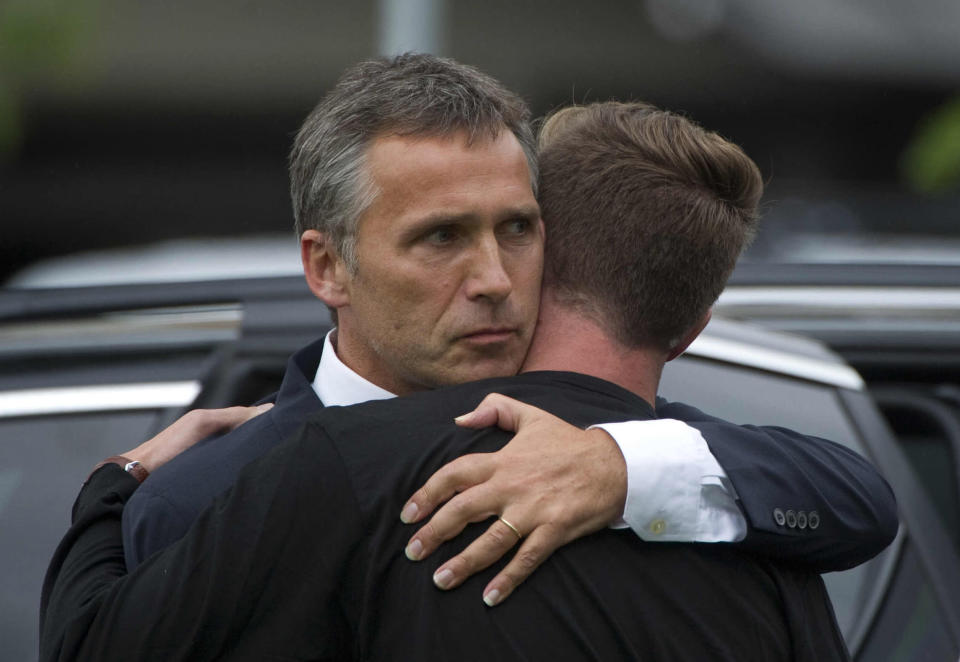 FILE - In this Saturday, July 23, 2011 file photo, Norway's Prime Minister Jens Stoltenberg, left, embraces the leader of the Labour party's youth group Eskild Pedersen who was on the island during the shooting attacks at Stoltenberg visited survivors at a hotel in Sundvolden, Norway. On the ten-year anniversary of Norway's worst peacetime slaughter, survivors of Anders Breivik's 22 July assault worry that the seam of racism that nurtured the anti-Islamic mass-murderer is re-emerging. Most of Breivik's 77 victims were teen members of the Labor Party Youth wing - idealists enjoying their annual camping trip on the tranquil, wooded island of Utoya. Today many survivors are battling to keep their vision for their country alive. (AP Photo, File)