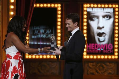Audra McDonald presents the award for Best Performance by an Actor in a Leading Role to Neil Patrick Harris during the American Theatre Wing's 68th annual Tony Awards at Radio City Music Hall in New York