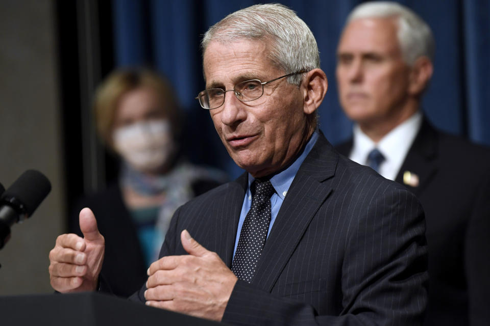 """FILE - In this June 26, 2020, file photo Director of the National Institute of Allergy and Infectious Diseases Dr. Anthony Fauci, center, speaks as Vice President Mike Pence, right, and Dr. Deborah Birx, White House coronavirus response coordinator, left, listen during a news conference with members of the Coronavirus task force at the Department of Health and Human Services in Washington. Fauci has warned that the United States could soon see 100,000 infections per day. """"We haven't even begun to see the end of it yet,"""" Fauci said during a talk hosted by Stanford University's School of Medicine. (AP Photo/Susan Walsh, File)"""