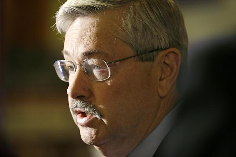 FILE - In this April 9, 2014 file photo, Iowa Gov. Terry Branstad speaks to reporters outside his formal office at the Statehouse in Des Moines, Iowa. Branstad is fending off multiple mini-scandals and has become a political target in a mid-term campaign that was supposed to be about the Democratic president's problems, not his. Republicans worry that the turmoil will roil the political waters as they attempt to win a U.S. Senate seat and control of the state Senate. (AP Photo/Charlie Neibergall, File)