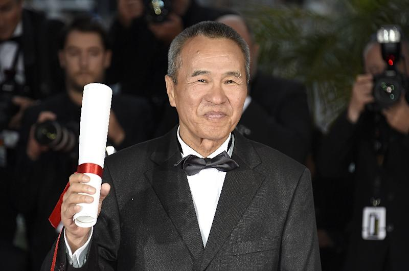 Taiwanese director Hou Hsiao-Hsien poses during a photocall after he was awarded with the Best Director prize, during the closing ceremony of the 68th Cannes Film Festival, in May 2015 (AFP Photo/Loic Venance)