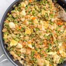 """<p>Our simple ingredient swap doubles the protein and slashes the carbs.</p><p>Get the <a href=""""https://www.delish.com/uk/cooking/recipes/a33922280/quinoa-fried-rice-recipe/"""" rel=""""nofollow noopener"""" target=""""_blank"""" data-ylk=""""slk:Quinoa Fried Rice"""" class=""""link rapid-noclick-resp"""">Quinoa Fried Rice</a> recipe.</p>"""