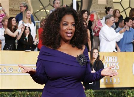 "Actress Oprah Winfrey from the film ""The Butler"" arrives at the 20th annual Screen Actors Guild Awards in Los Angeles"