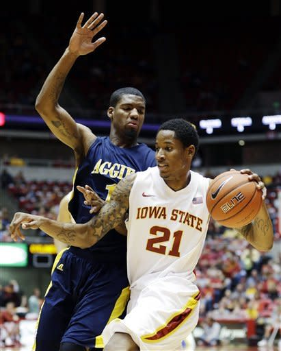 Iowa State guard Will Clyburn (21) drives past North Carolina A&T forward Adrian Powell during the first half of an NCAA college basketball game, Tuesday, Nov. 20, 2012, in Ames, Iowa. (AP Photo/Charlie Neibergall)