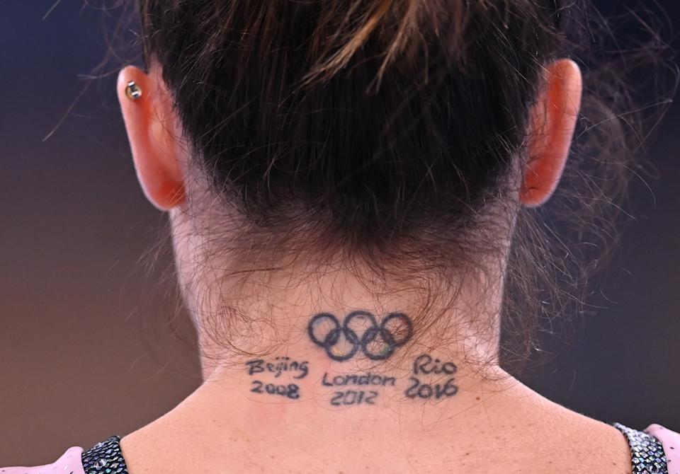 <p>Tokyo 2020 Olympics - Gymnastics Artistic Training - Ariake Gymnastics Centre, Tokyo, Japan - July 22, 2021 A Olympic rings tattoo is seen on the neck of Vanessa Ferrari of Italy during training REUTERS/Dylan Martinez</p>