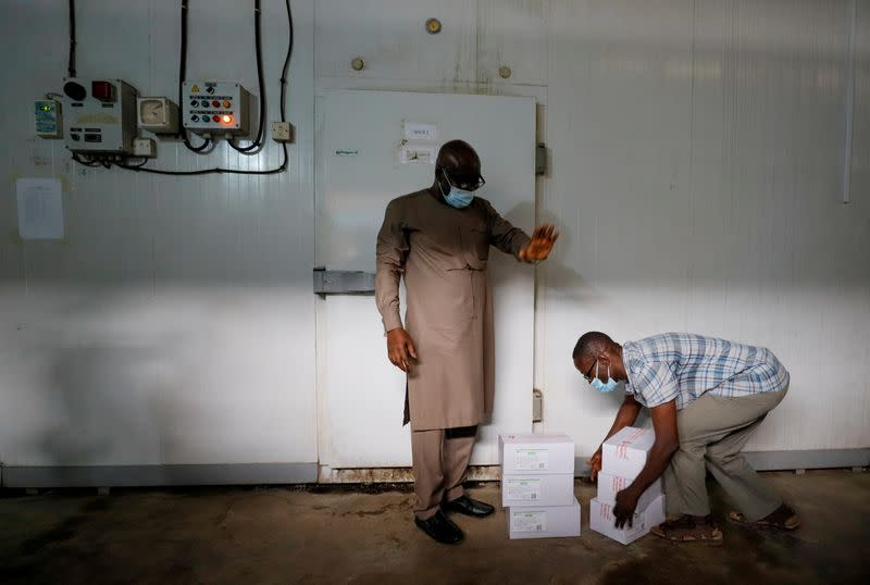 FILE PHOTO: A worker prepares to store boxes of vaccines in a cold room as the country receives its first batch of coronavirus disease (COVID-19) vaccines under COVAX scheme, in Accra