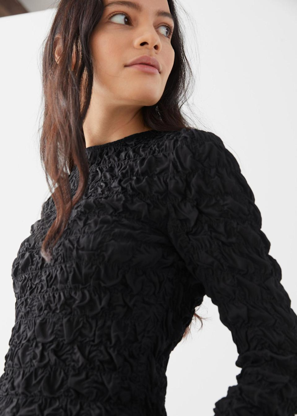 <p>This <span>&amp; Other Stories Smocked Round Collar Top</span> ($49, originally $99) is absolute steal!</p>