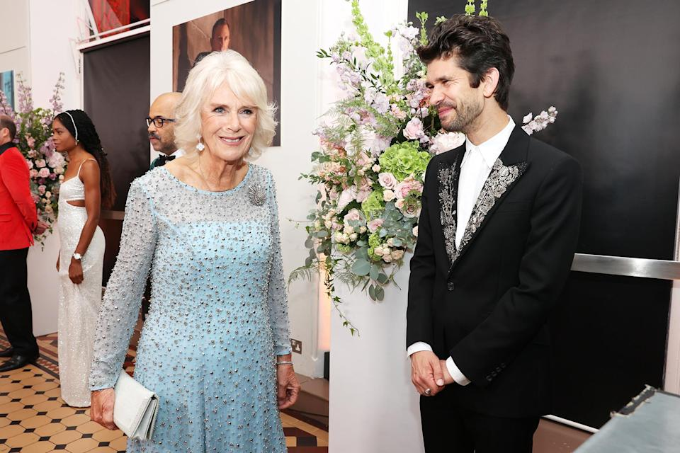 <p>Whishaw, here with Camilla, reprises his role as Q in the films. </p>
