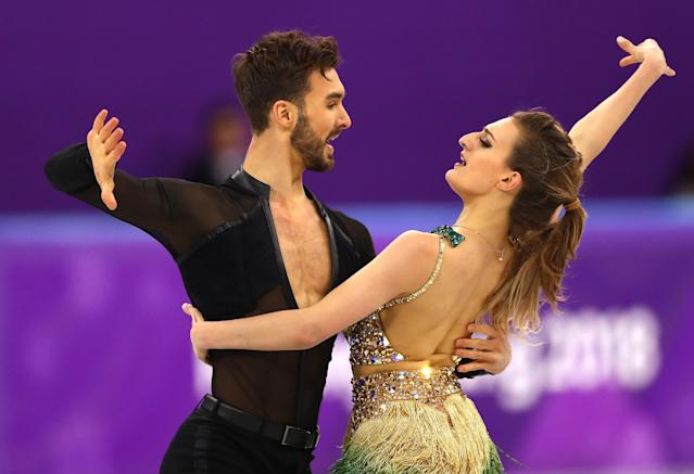 <p>Gabriella Papadakis and Guillaume Cizeron of France compete during the Figure Skating Ice Dance Short Dance on day 10 of the PyeongChang 2018 Winter Olympic Games at Gangneung Ice Arena on February 19, 2018 in Pyeongchang-gun, South Korea. (Photo by Dean Mouhtaropoulos/Getty Images) </p>