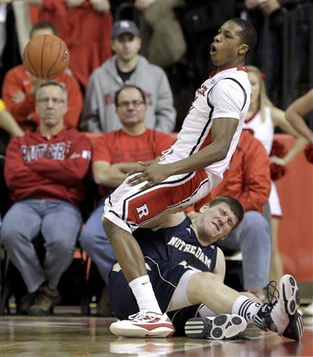 Rutgers' Mike Poole, top, and Notre Dame's Jack Cooley collide while competing for the ball during the second half of an NCAA college basketball game, Monday, Jan. 16, 2012, in Piscataway, N.J. Rutgers won 65-58. (AP Photo/Julio Cortez)