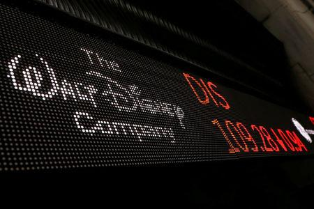 FILE PHOTO: A logo of Walt Disney company is displayed on a monitor outside of the New York Stock Exchange shortly after the opening bell in New York, U.S., December 5, 2017.  REUTERS/Lucas Jackson/File Photo