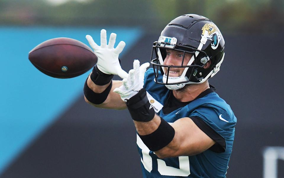 Jaguars DT (85) Tim Tebow pulls in a pass on the practice fields outside TIAA Bank Field during the Jacksonville Jaguars  mandatory veterans minicamp session Monday morning, June 14, 2021. [Bob Self/Florida Times-Union]