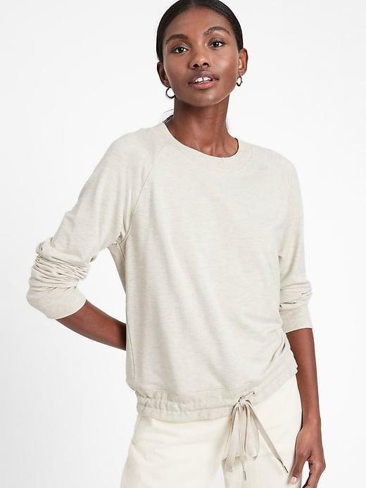 <p>You can safely stash your heavy sweatshirts and make this <span>Banana Republic Baby Terry Drawstring-Hem Sweatshirt</span> ($34, originally $50) your new go-to.</p>