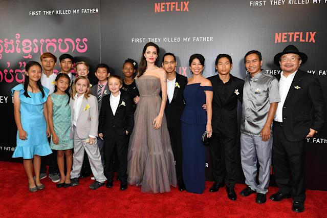 "<p><em>First They Killed My Father — based on </em>Cambodian author Loung Ung's book about the horrors she suffered under the rule of the deadly Khmer Rouge — was a family affair for Angelina. She directed the film and let <a href=""https://www.yahoo.com/entertainment/maddox-jolie-pitt-praises-apos-211455644.html"" data-ylk=""slk:16-year-old Maddox, whom she adopted from Cambodia, executive-produce, while Pax, 13, served as a set photographer;outcm:mb_qualified_link;_E:mb_qualified_link"" class=""link rapid-noclick-resp newsroom-embed-article"">16-year-old Maddox, whom she adopted from Cambodia, executive-produce, while Pax, 13, served as a set photographer</a>. So the actress has been bringing her whole crew out in support of the film, including to the NYC premiere on Sept. 14, where they posed with Ung and various stars and producers of the flick. (Photo: Dia Dipasupil/Getty Images) </p>"