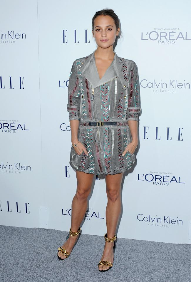 "<p>Wearing a boho-chic dress from her favorite brand Louis Vuitton with gold sandals fit for a Greek Goddess, Alicia Vikander opened up about working in Hollywood. ""Last year I found myself on a set, I think it was one of my first days of filming, and I had just finished a scened and I had one of those good feelings, I thought it went well, but I had a kick, like it was a challenge,"" she said in her speech. ""And I wondered what it was that made it feel different and we both suddenly looked up and in that moment I realized that throughout the three films that I had done leading up to this one was the first that I found myself in a scene with another woman."" </p>"