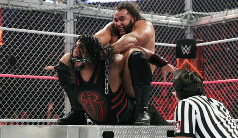 Rusev performs a submission move on Roman Reigns