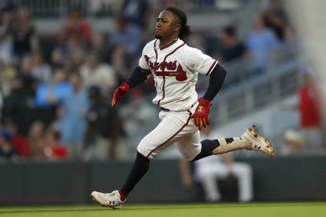 Atlanta Braves' Ozzie Albies runs on a tripled during the first inning of the team's baseball game against the Philadelphia Phillies on Tuesday, Sept. 17, 2019, in Atlanta. (AP Photo/John Bazemore)