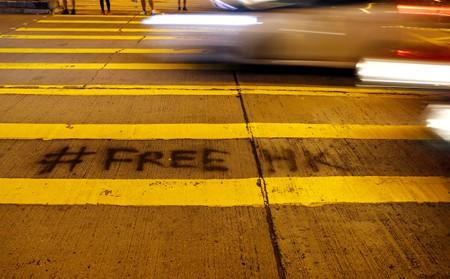 FILE PHOTO: A graffiti is seen at a pedestrian crossing near the Police station at Mong Kok district in Hong Kong